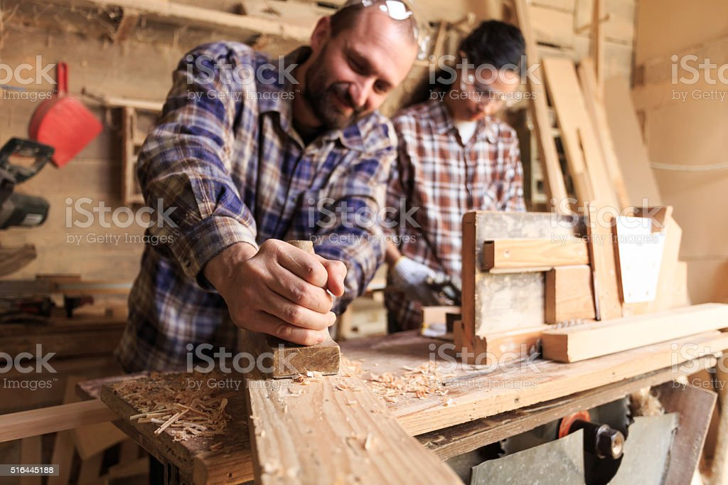 Couple carpenter workers stock photo