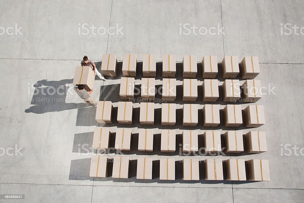 Couple carrying box stock photo
