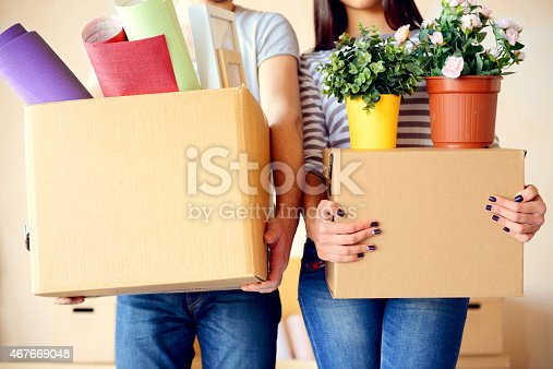 istock A couple carrying boxes while moving to a new house 467669048