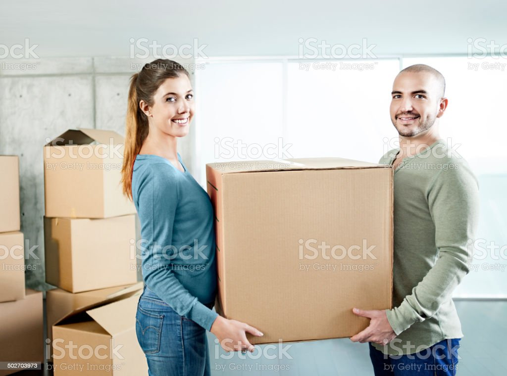 Couple carrying cardboard boxes royalty-free stock photo