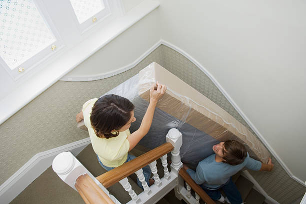 couple carrying mattress upstairs - carrying stock pictures, royalty-free photos & images