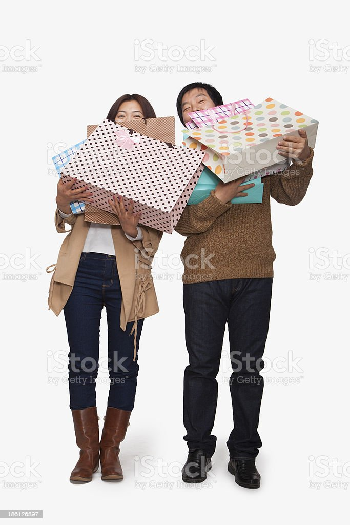 Couple carrying shopping bags royalty-free stock photo