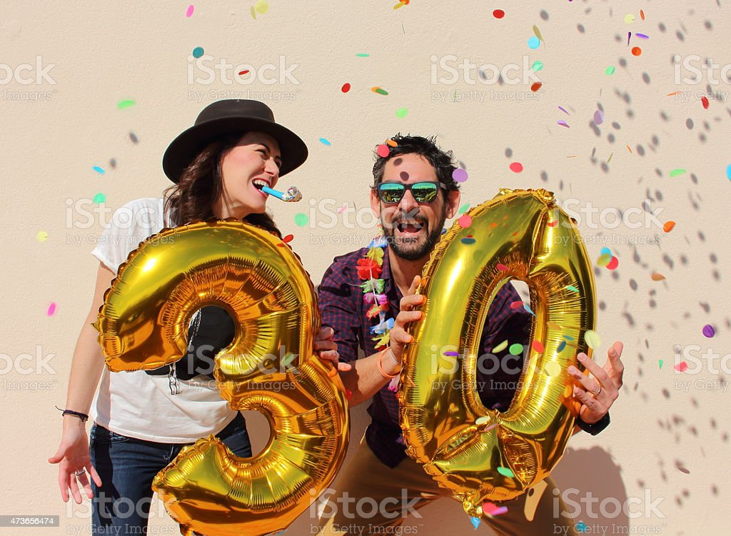 Couple celebrating a 30th birthday party stock photo