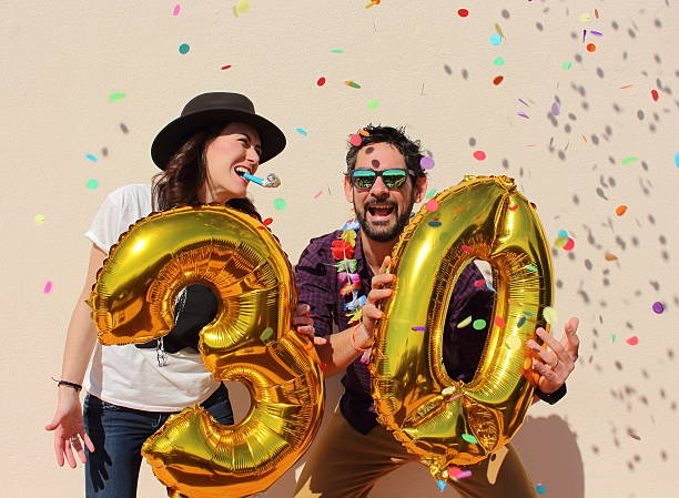 couple celebrating a 30th birthday party - number 30 stock photos and pictures