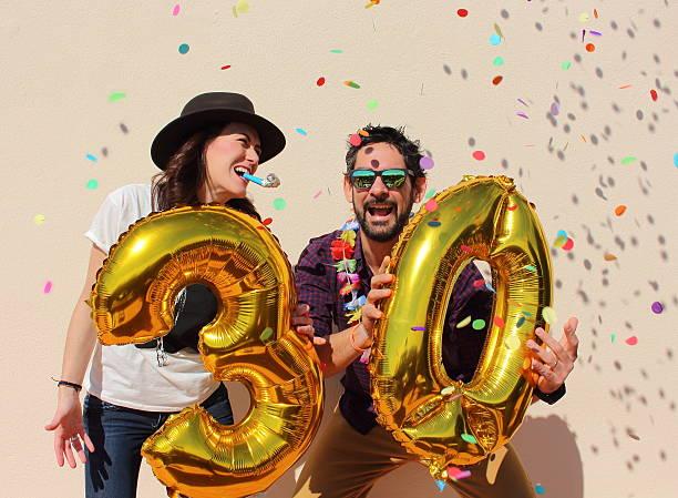 Couple celebrating a 30th birthday party stock photo