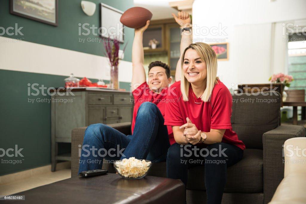 Couple celebrating a touchdown stock photo