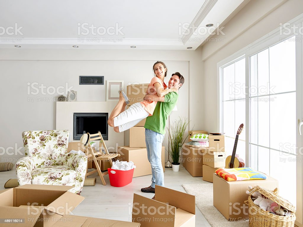 Couple celebrating moving in to a new home stock photo