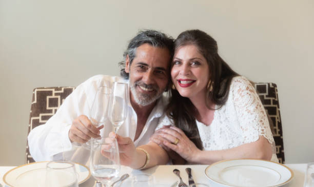Couple celebrating new year day Coulee celebrating New Year`s Eve in Brazil, at the table for supper reveillon stock pictures, royalty-free photos & images