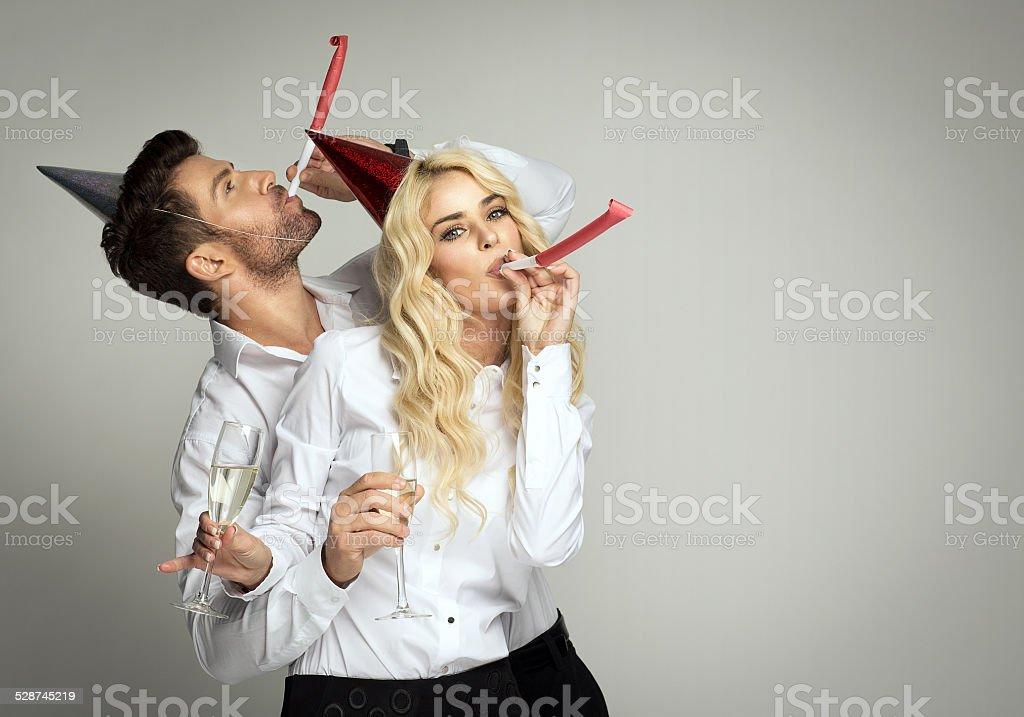 Couple celebrating new year's eve stock photo