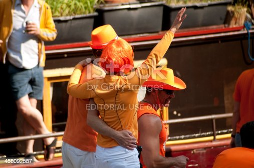 istock Couple Celebrating Queen's Day on a Boat 458092587
