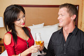 istock Couple celebrating something with champagne in the hotel room 183045702