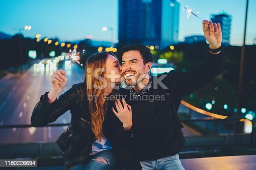 Young woman kissing her boyfriend celebrating together Valentine's day