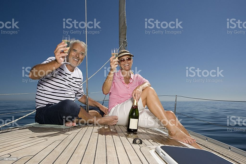 Couple celebrating with champagne stock photo