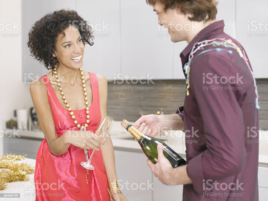 Couple celebrating with champagne royalty-free stock photo