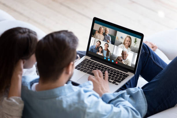 Couple chatting with relatives via videoconference video call application stock photo