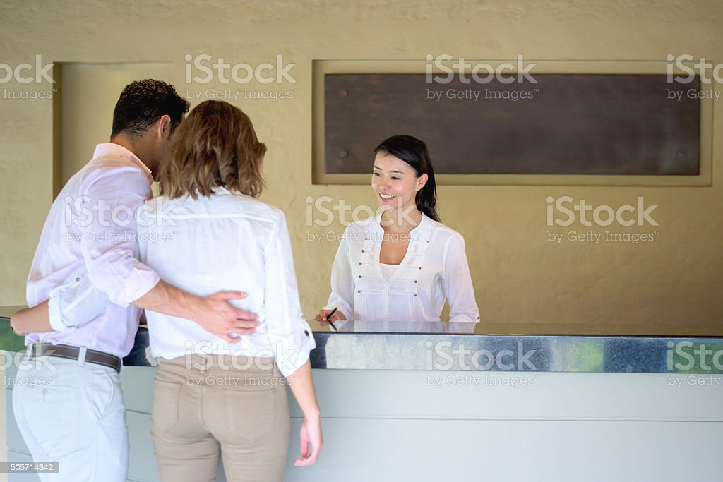 Couple checking in at a hotel stock photo