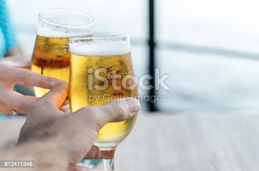istock couple cheers with beer 812411348