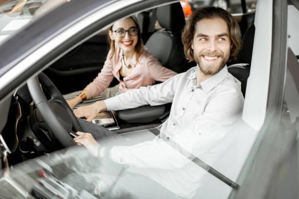 Cтоковое фото Couple choosing car in the showroom