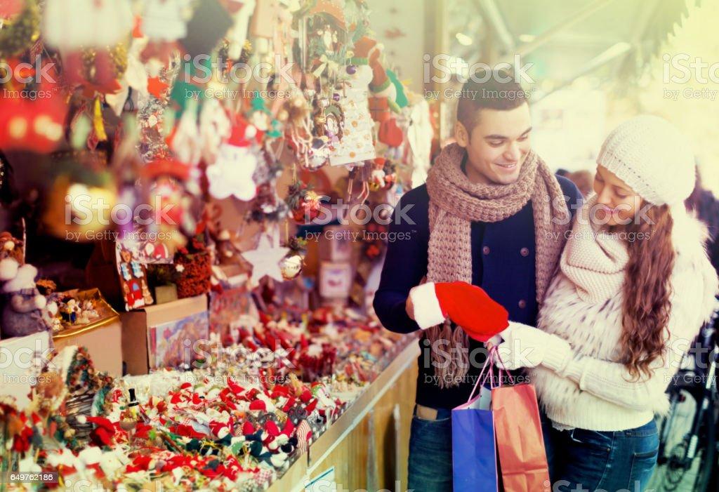 Couple choosing Christmas decoration stock photo