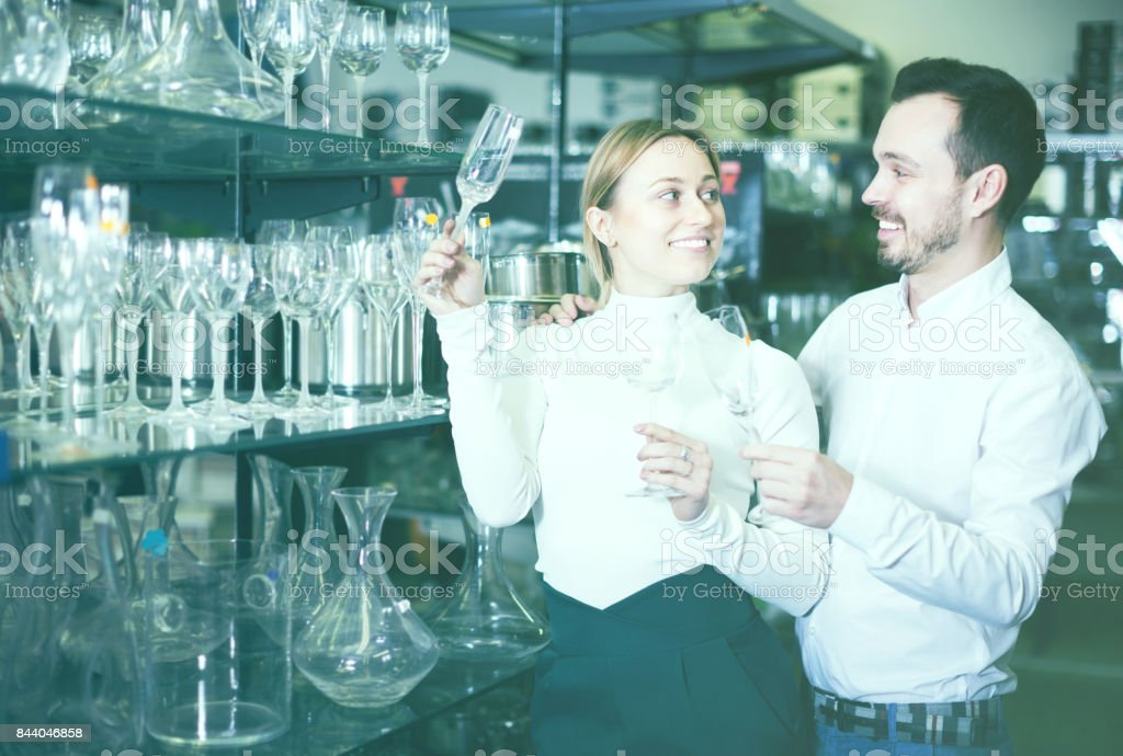 Couple choosing glasses in store stock photo