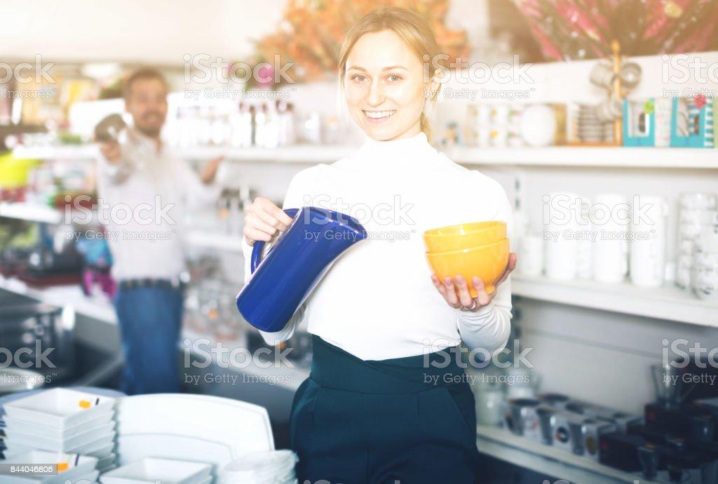 Couple choosing new crockery in dinnerware store stock photo