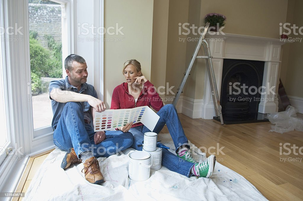 Couple choosing paint colors in new home stock photo