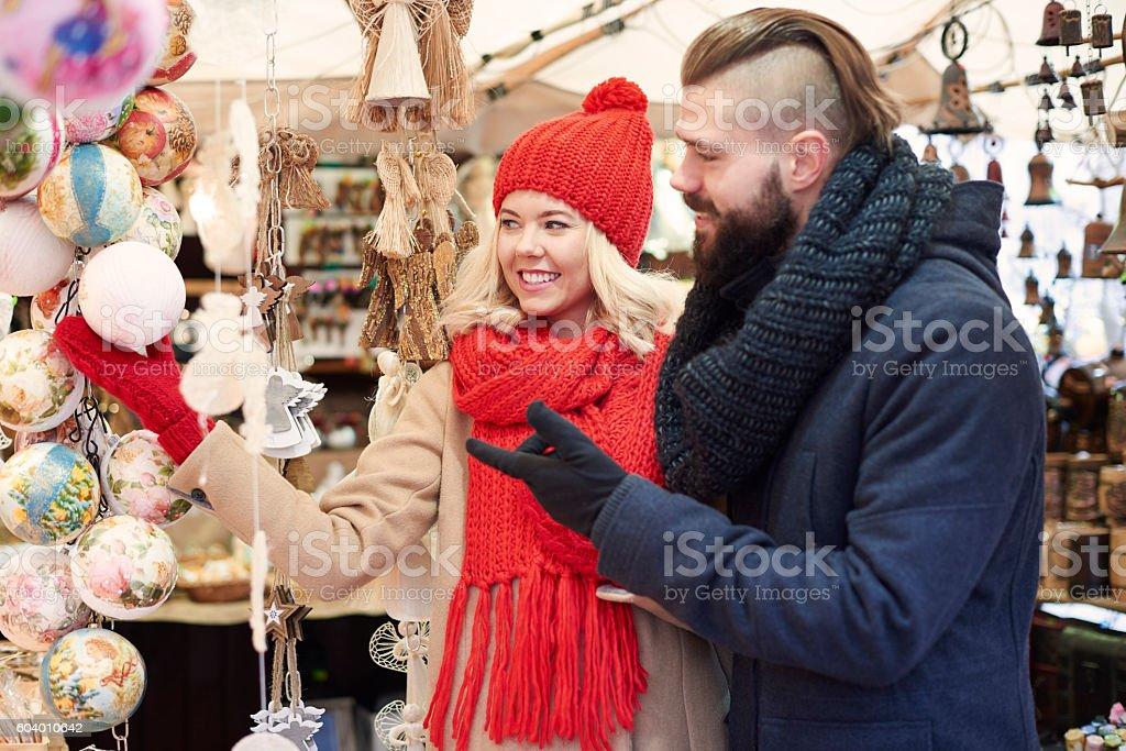 Couple chosing some christmas balls stock photo