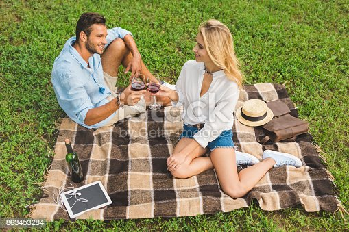 istock couple clinking glasses of wine on date 863453284