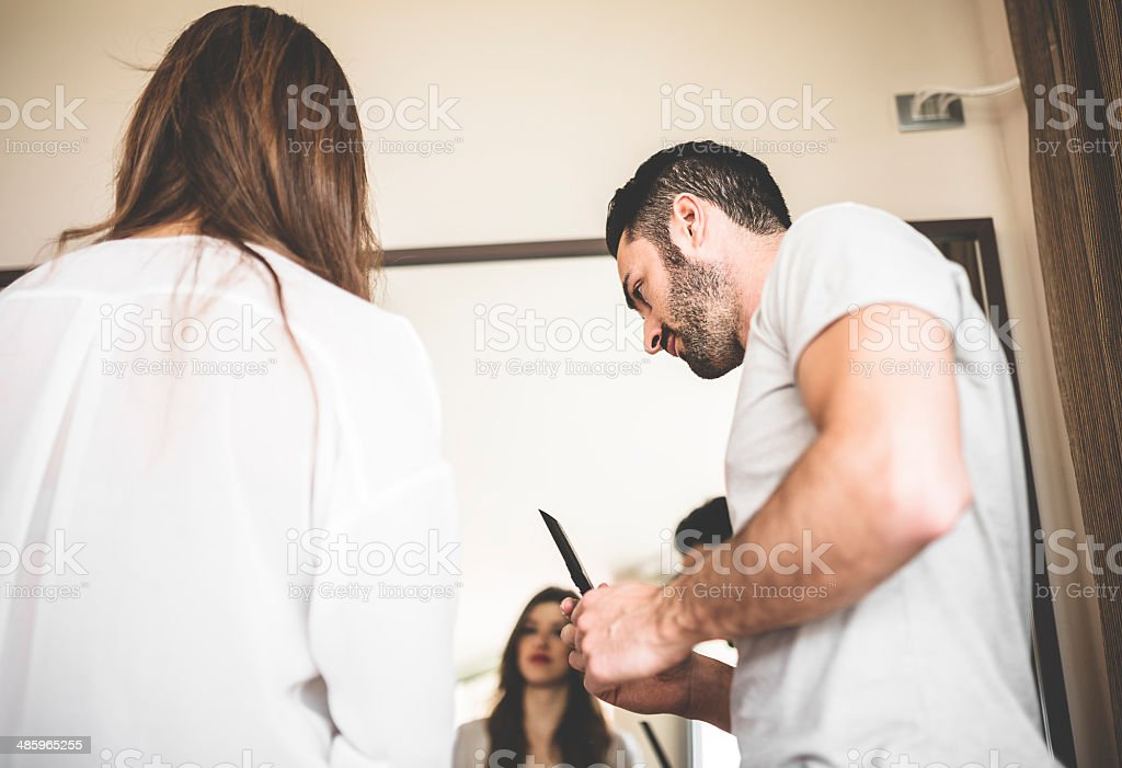 couple combing the hair in front of mirror royalty-free stock photo