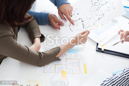 istock Couple consult a look at the sketch. 613226038