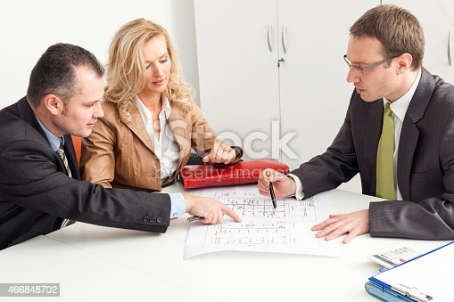 466848706 istock photo Couple Consulting Buying New House 466848702