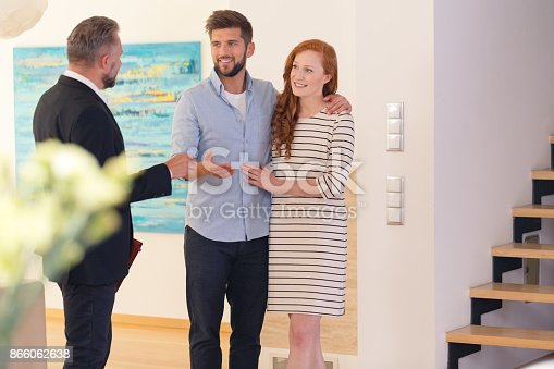 istock Couple consulting with estate agent 866062638