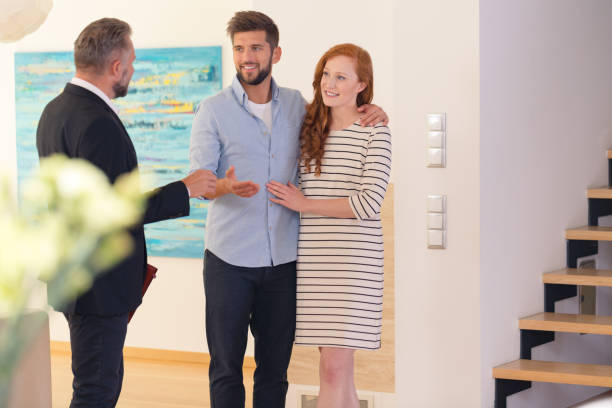 Couple consulting with estate agent stock photo