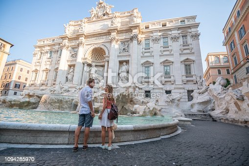 Couple contemplating the Trevi fountain in Rome, Italy People travel enjoying capital cities of Europe concept