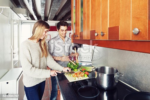istock Couple Cooking a Meal 531394292