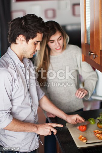 istock Couple Cooking a Meal 539117408