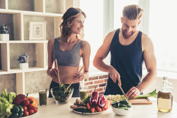 Couple cooking healthy food stock photo