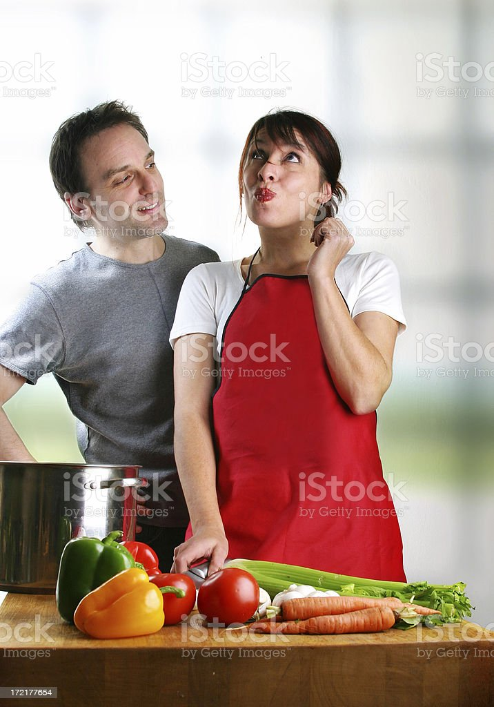 Couple cooking royalty-free stock photo