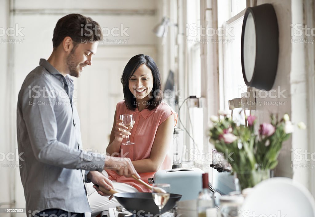 Couple cooking together stock photo