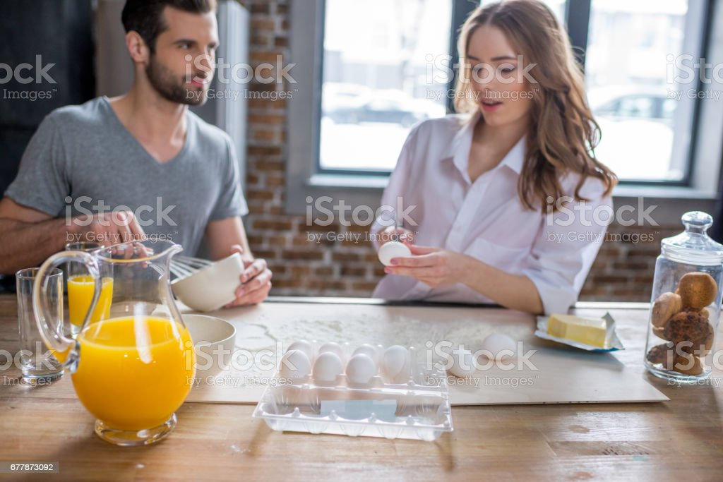 Couple cooking together royalty-free stock photo