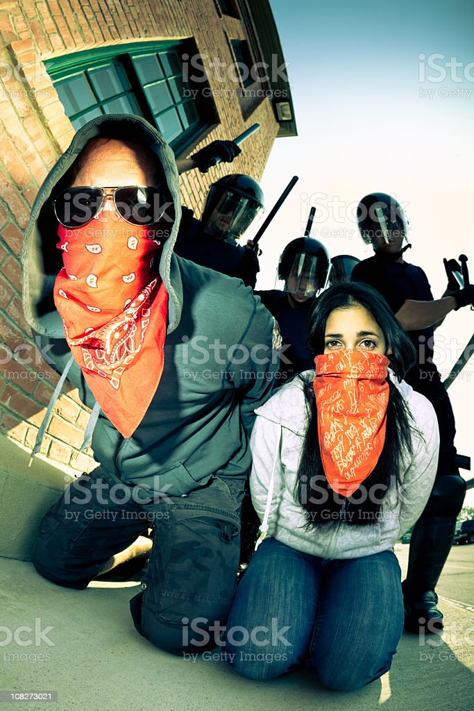 Couple cought in a Riot - No Way Out royalty-free stock photo