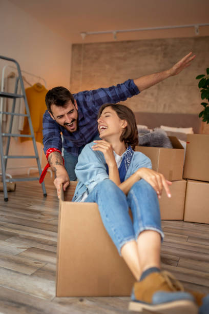 Couple couple having fun while moving in stock photo