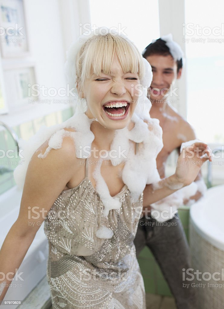 Couple covered with soap suds in bathroom royalty-free stock photo