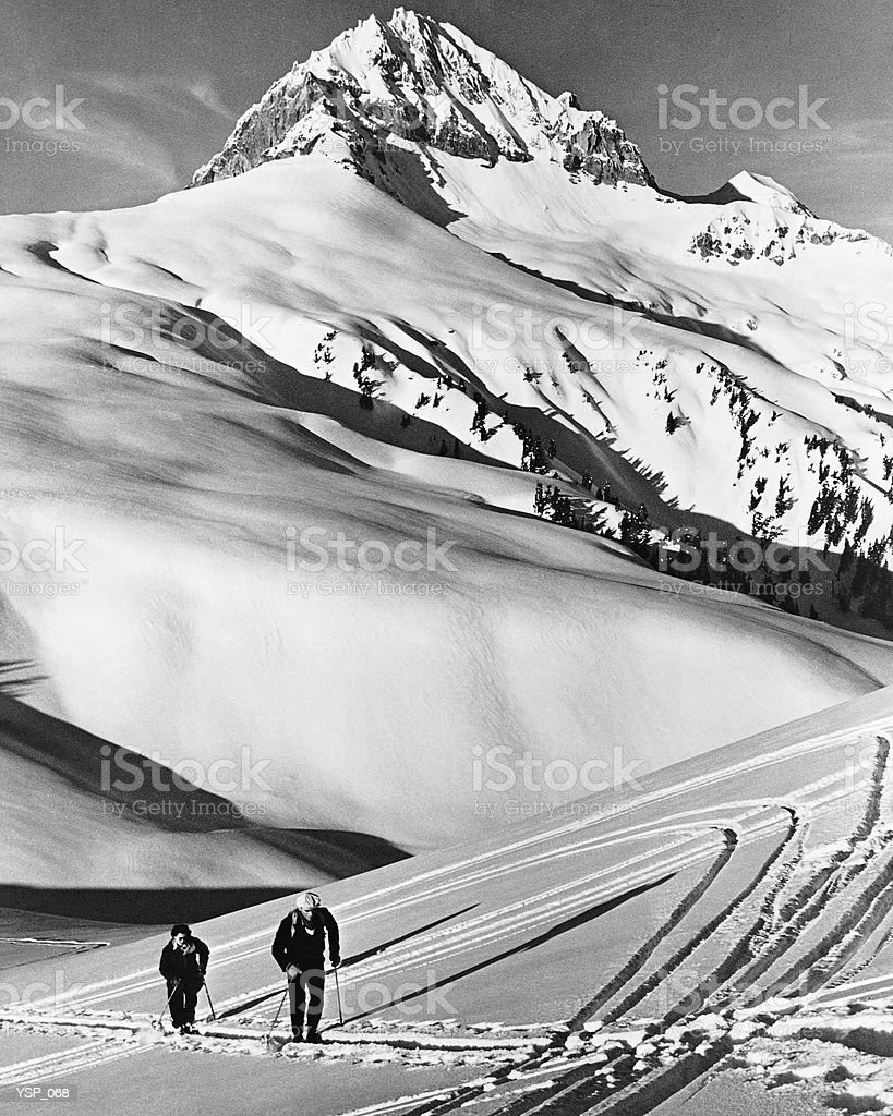 Couple cross-country skiing in mountains royalty-free stock photo