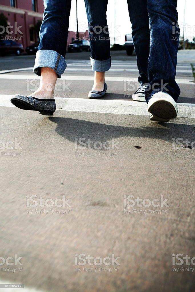 Couple Crossing the Cross Walk royalty-free stock photo