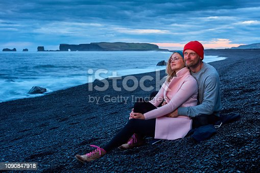 Man and Woman on rocky beach background. Cuddling