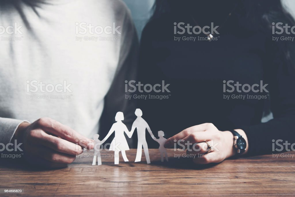 couple cupped hands showing paper man family royalty-free stock photo