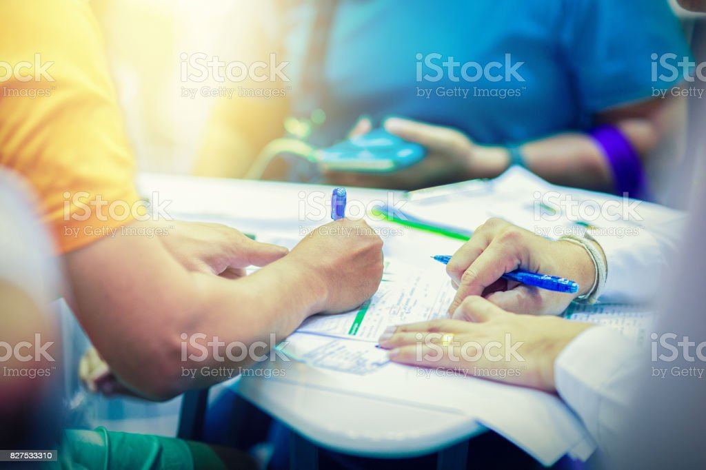 couple customers are signing a contract with the sale manager stock photo