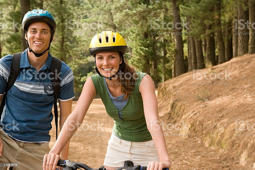 Couple cycling in forest royalty-free stock photo