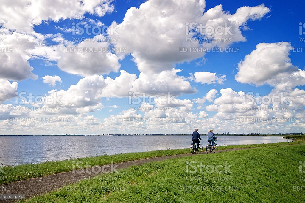 Couple Cycling on a Dike stock photo